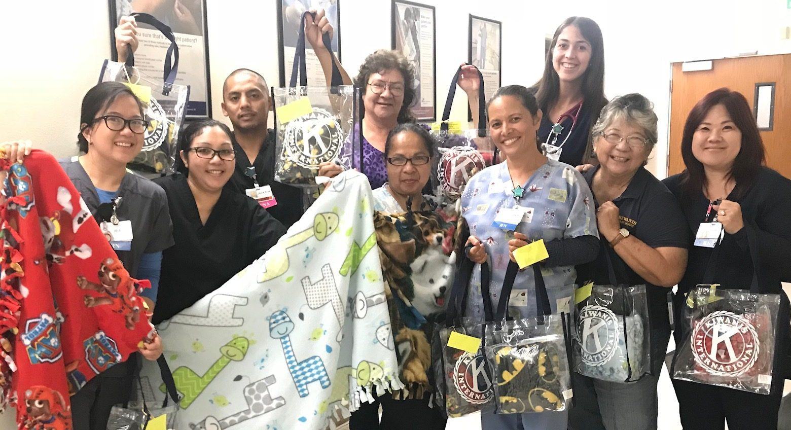 Kiwanis blanket donation with staff