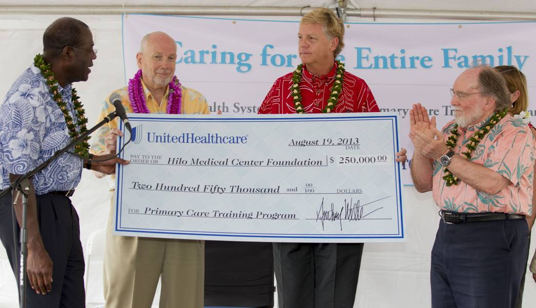 Big check is handed to recipient from UnitedHealthcare
